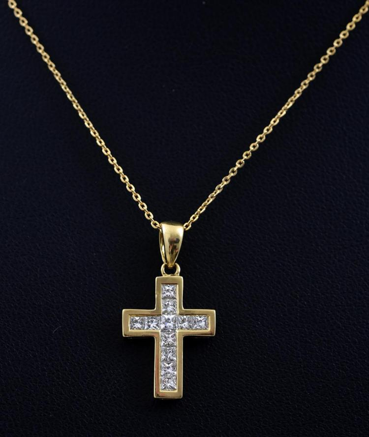 A PRINCESS CUT DIAMOND SET CROSS AND CHAIN IN GOLD