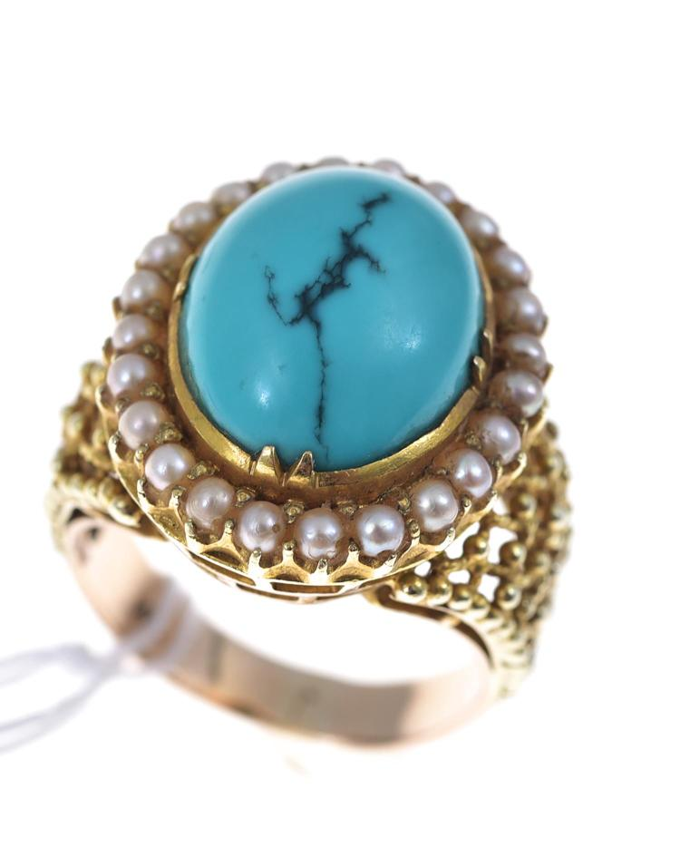 A TURQUOISE AND SEED PEARL RING SET IN 14CT GOLD