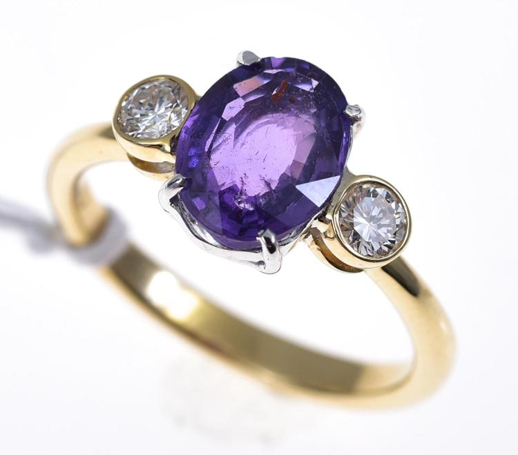A PURPLE SAPPHIRE AND DIAMOND RING