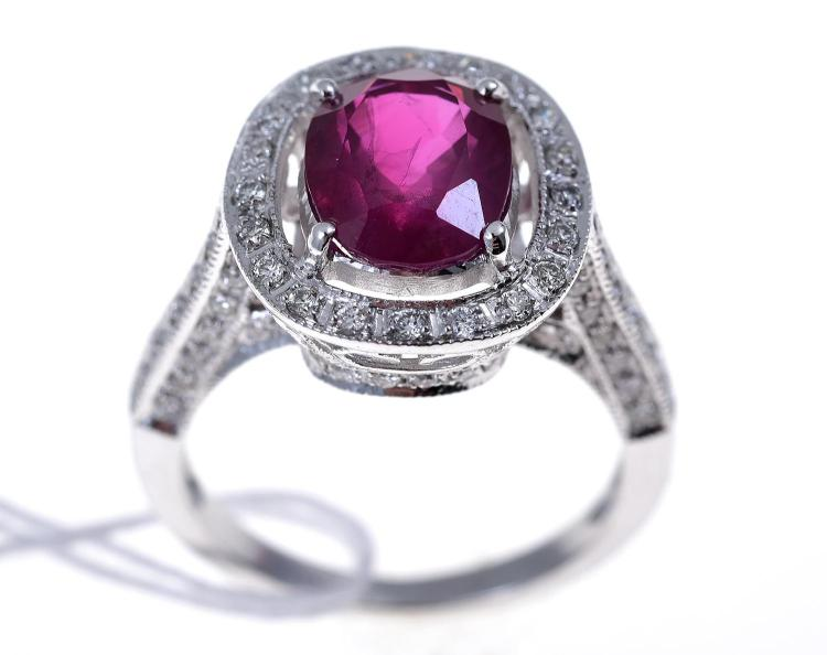 A BURMESE RUBY AND DIAMOND RING IN WHITE GOLD