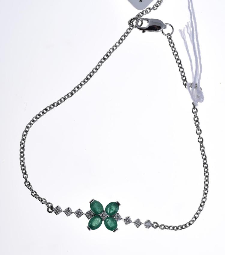 A DIAMOND AND TREATED EMERALD BRACELET, OF FLORAL DESIGN, IN 18CT WHITE GOLD