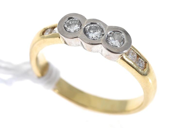 A BEZEL SET DIAMOND DRESS RING, IN 18CT GOLD