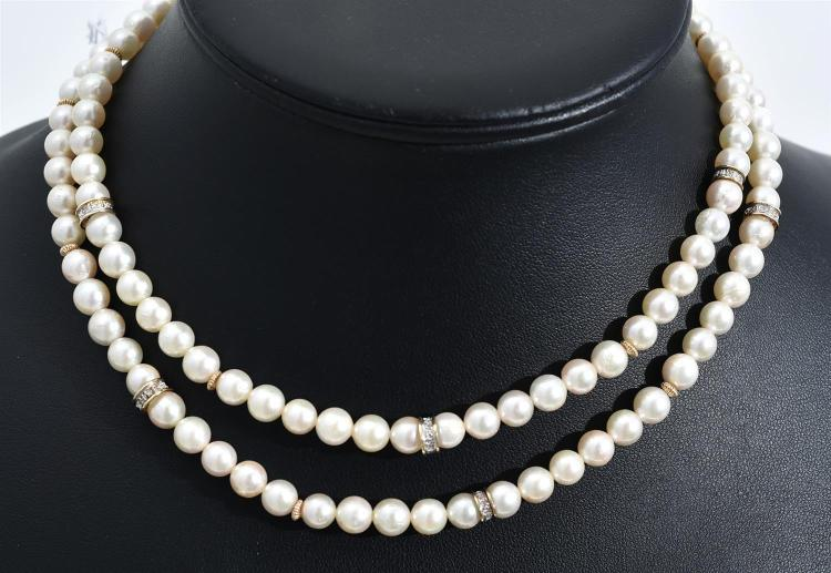 A STRAND OF CULTURED PEARLS WITH DIAMOND SET SPACERS AND A 14CT GOLD CLASP