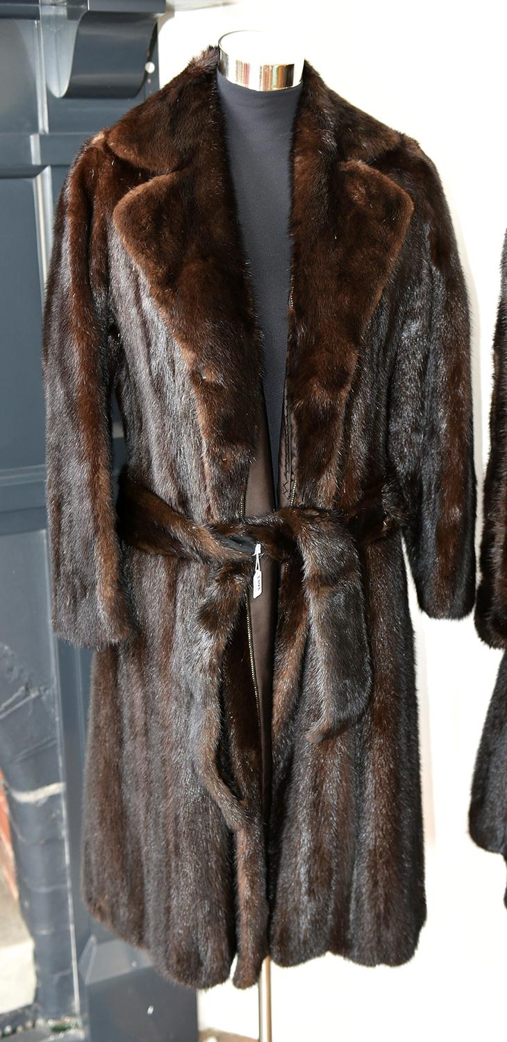 A MINK COAT WITH BELL SLEEVES