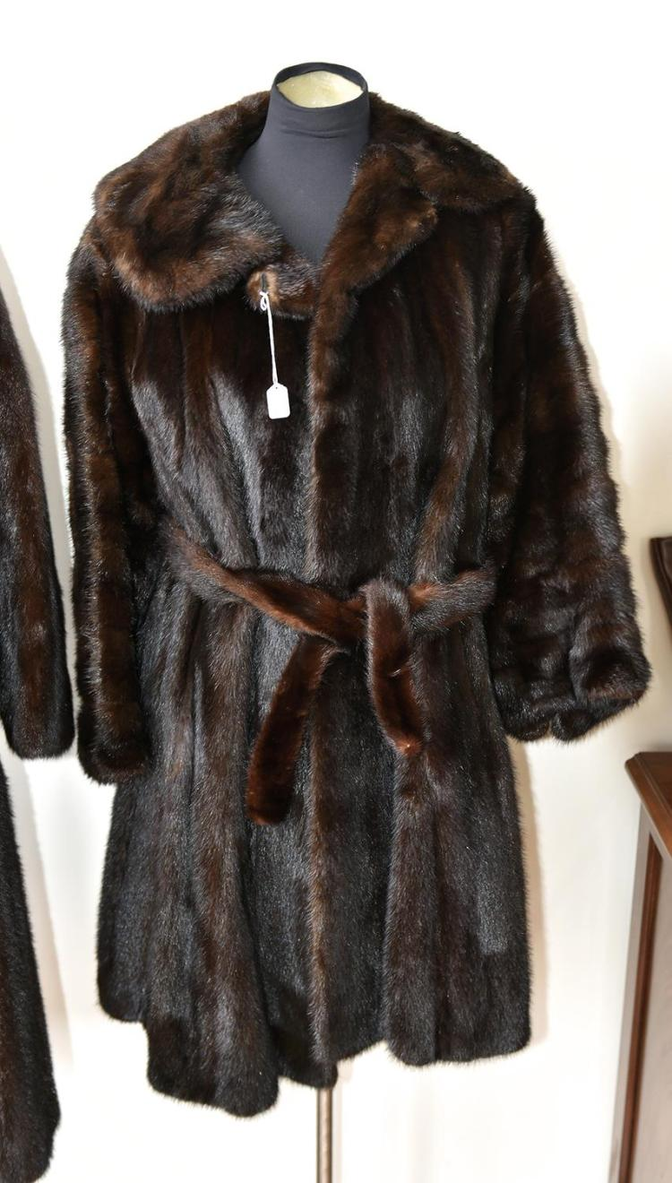 A FULL LENGTH FUR  COAT WITH KNOTCHED COLLAR