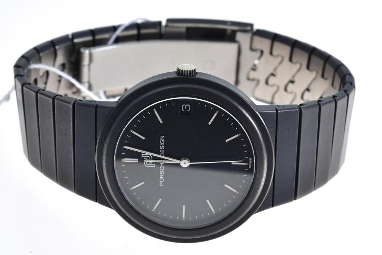 A PORSCHE DESIGN WRISTWATCH WITH BOX AND PAPERS, SIGNED IWC CASE AND MOVEMENT. WITH TITANIUM CASE AND BANDS, NUMBERED 2354447/3317