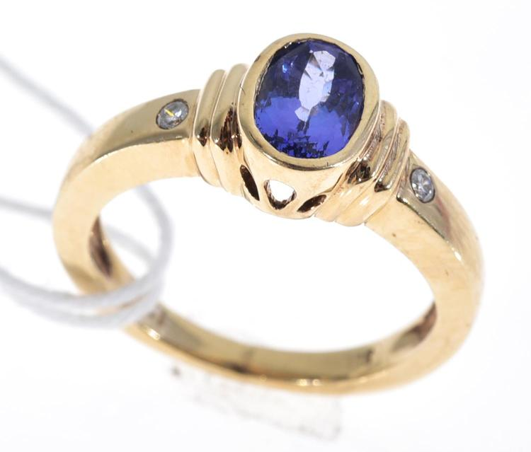 A TANZANITE AND DIAMOND RING IN 14CT GOLD