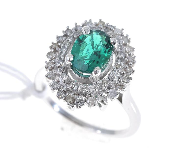 A ZAMBIAN EMERALD AND DIAMOND CLUSTER RING, EMERALD WEIGHING 1.20CTS, DIAMONDS TOTALLING 0.40CTS IN 14CT WHITE GOLD