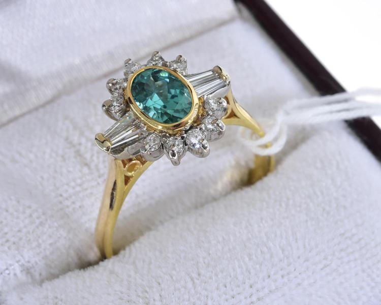 A TOURMALINE AND DIAMOND RING, TOURMALINE WEIGHING 0.88CT, WITH A TOTAL DIAMOND WEIGHT 0.44CT, MOUNTED IN 18CT GOLD, RETAILED BY HOL...