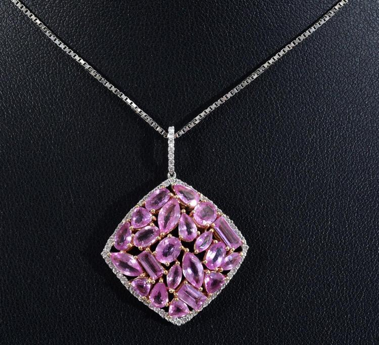 A PINK SAPPHIRE AND DIAMOND PENDANT SET IN 18CT GOLD SUSPENDED ON A SILVER CHAIN