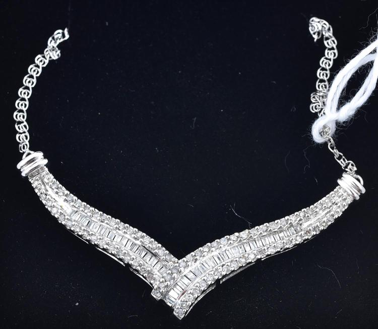 A BAGUETTE AND ROUND BRILLIANT CUT DIAMOND NECKLACE, WITH AN APPROXIMATE TOTAL DIAMOND WEIGHT OF 1.08CTS, MOUNTED IN 14CT GOLD