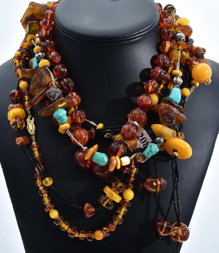 FOUR ASSORTED AMBER NECKLACES INCLUDING VINTAGE