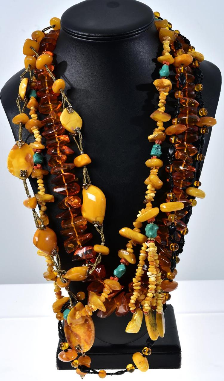 FOUR ASSORTED AMBER NECKLACES INCLUDING VINTAGE.