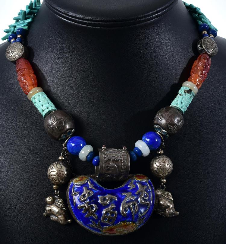 A VINTAGE TURQUOISE, CARNELIAN, LAPIS LAZULI, SILVER AND ENAMEL NECKLACE.