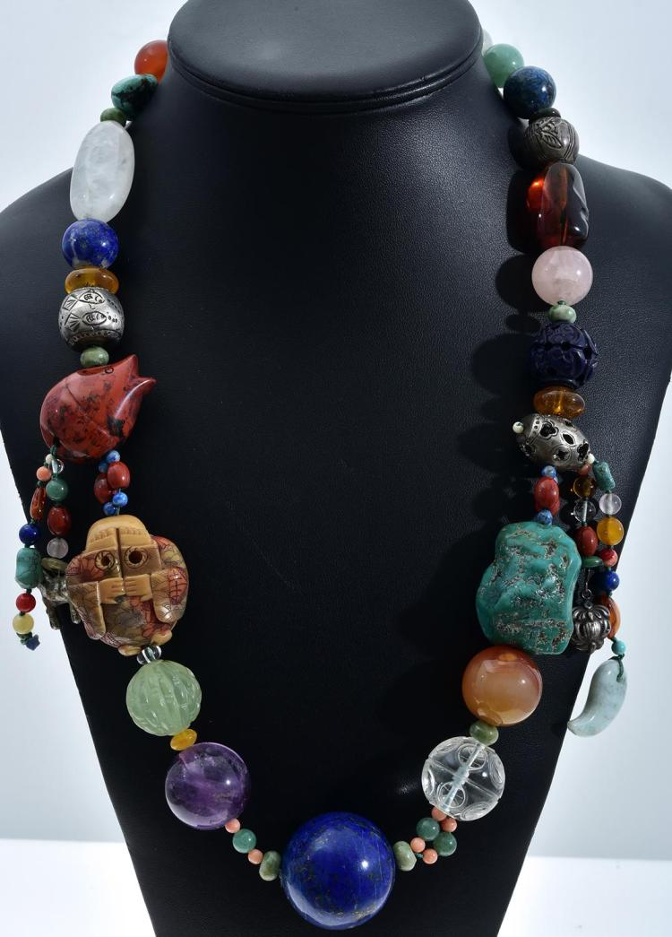 A TRIBAL SEMI PRECIOUS STONE SET NECKLACE INCLUDING ROCK QUARTZ, TURQUOISE, LAPIS LAZULI, CARNELIAN, SILVER, ENAMEL ETC