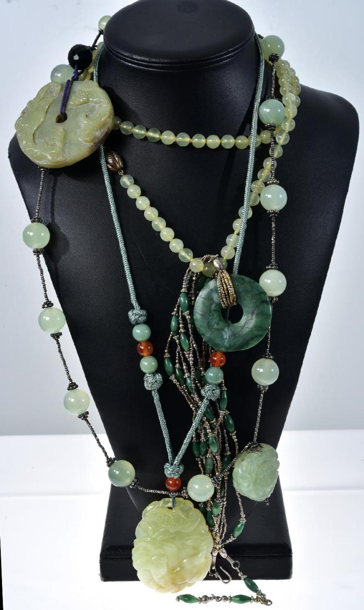 FIVE ASSORTED JADEITE AND GREEN QUARTZ NECKLACES AND PENDANTS, INCLUDING POLISHED AND CARVED PIECES.