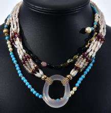THREE ASSORTED SEMI PRECIOUS NECKLACES INCLUDING TURQUOISE, SEED PEARL, GARNET, TOURMALINE AND GOLD.