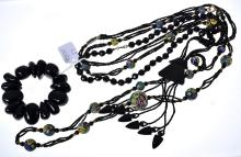 THREE ASSORTED VINTAGE BLACK BEAD NECKLCAES INCLUDING VENETIAN GLASS AND A BLACK BRACELET