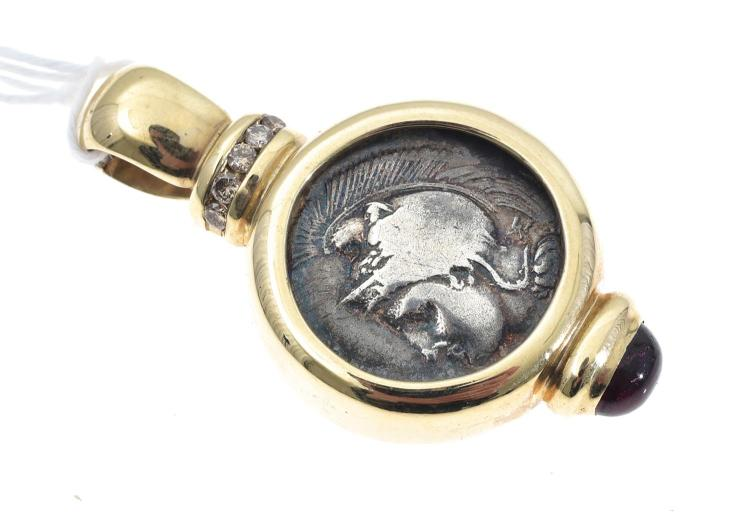 A COIN PENDANT SET WITH DIAMONDS AND GARNET MOUNTED IN 9CT GOLD