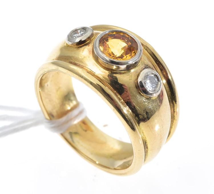 A YELLOW SAPPHIRE AND DIAMOND DRESS RING SET IN 18CT GOLD.