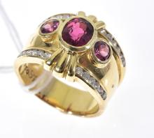 A TOURMALINE AND DIAMOND DRESS RING SET IN 18CT GOLD