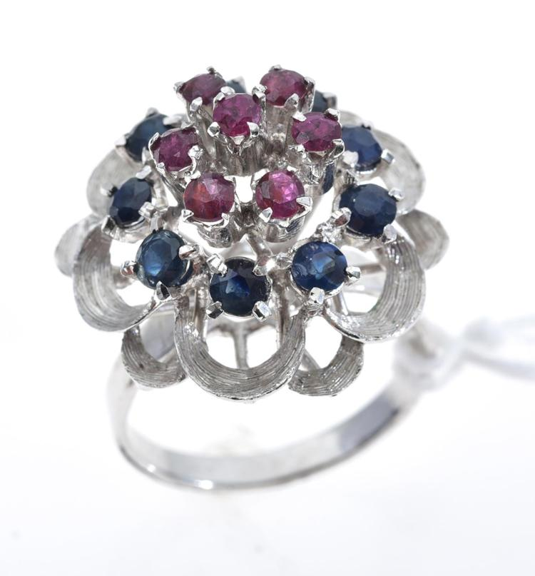 A SILVER, RUBY AND SAPPHIRE CLUSTER RING.