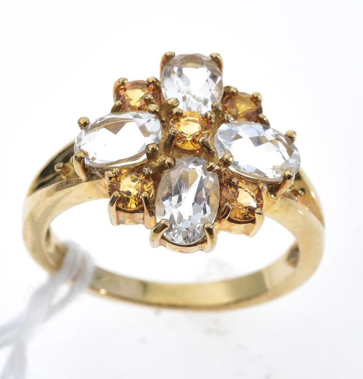 A WHITE TOPAZ AND YELLOW SAPPHIRE RING MOUNTED IN 9CT GOLD