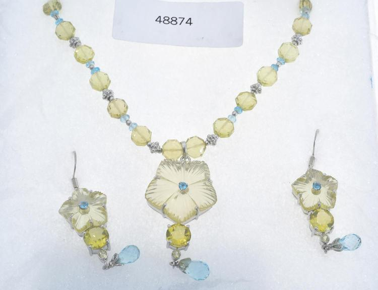 A MULTI GEM SET FLORAL NECKLACE WITH MATCHING EARRINGS SEET IN STERLING SILVER