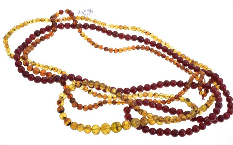 THREE STRANDS OF RECONSTITUTED AMBER