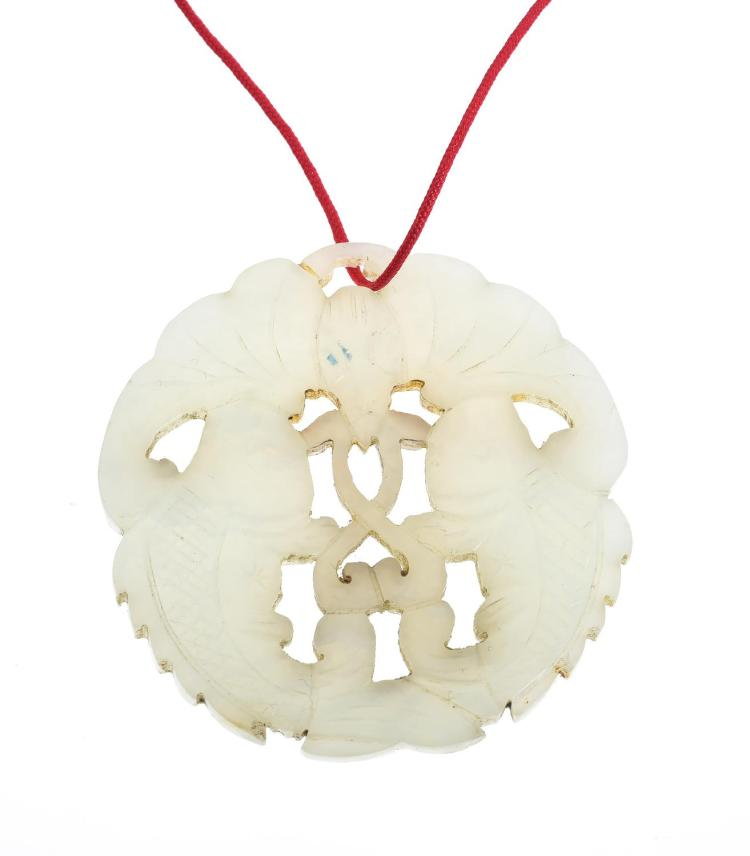 A JADE PENDANT WITH FISH MOTIF