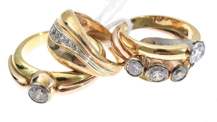 FOUR ASSORTED GOLD AND CUBIC ZIRCONIA SET RINGS
