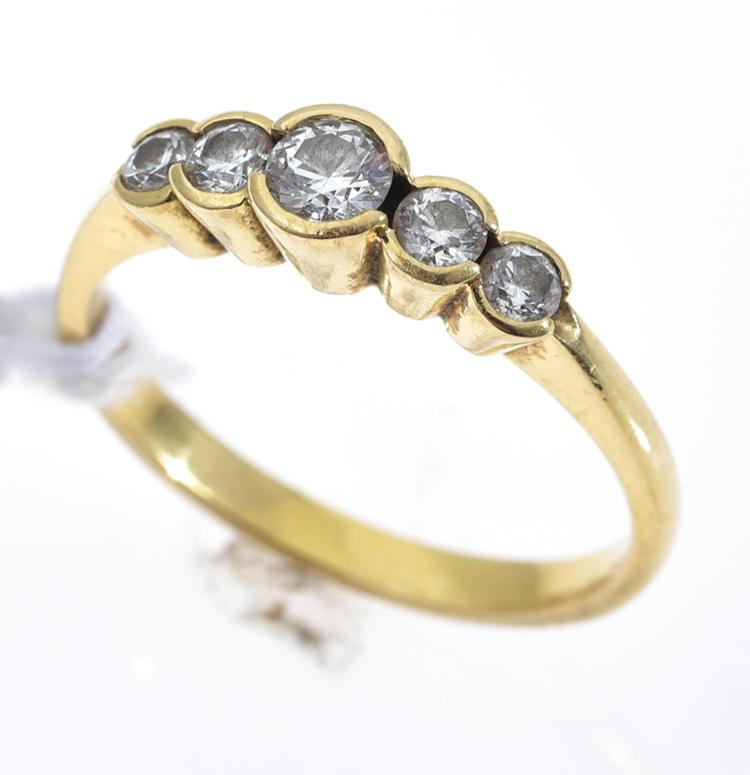 A FIVE DIAMOND DRESS RING IN 18CT GOLD