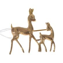 A GOLD DEER BROOCH SET IN 18CT.