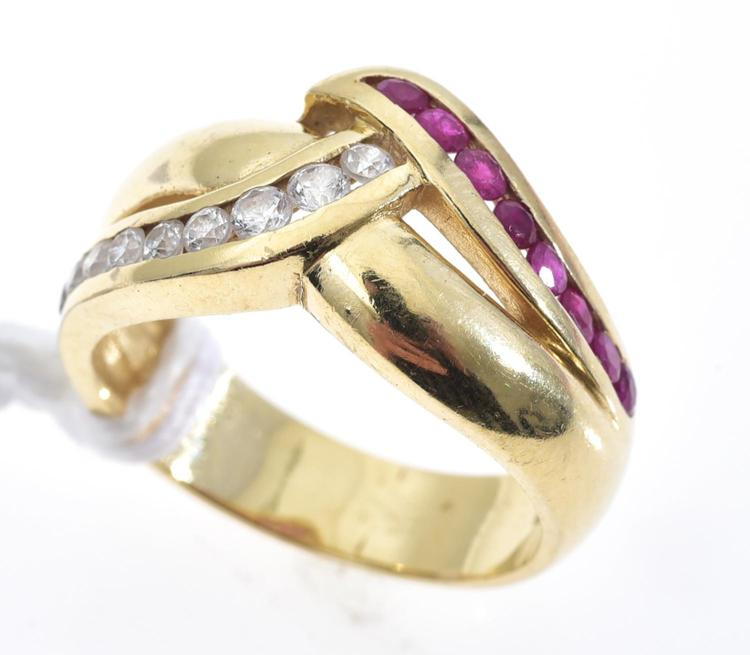 A RUBY AND DIAMOND DRESS RING IN 18CT GOLD