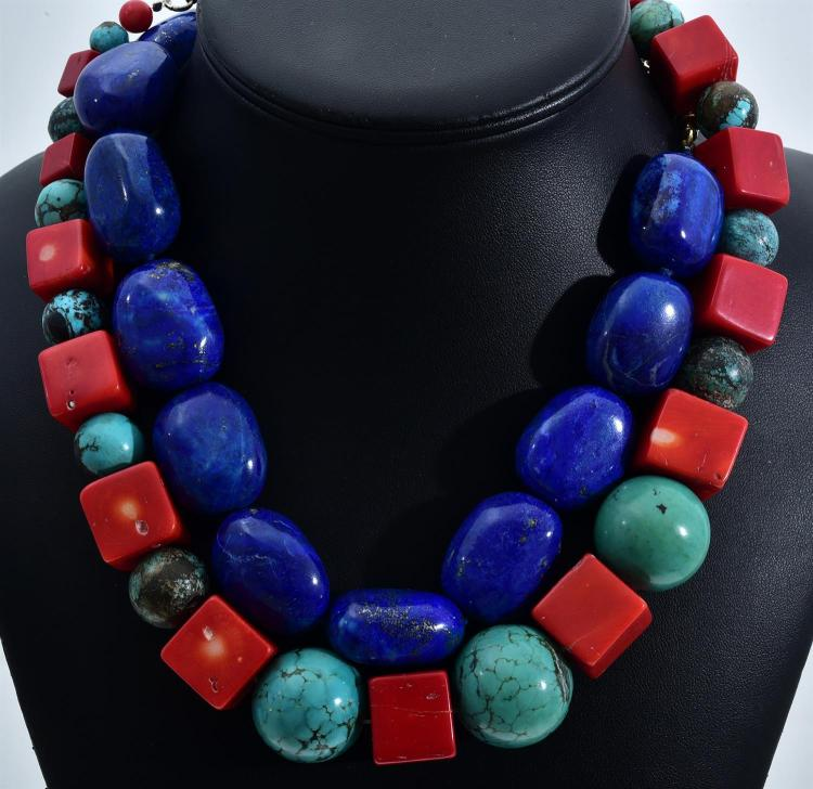 A POLISHED LAPIS LAZULI NECKLACE AND A CORAL AND TURQUOISE NECKLACE