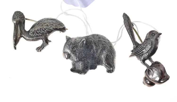 THREE HANDCRAFTED TONY KEAN STERLING SILVER ANIMAL BROOCHES INCLUDING PELICAN, WOMBAT AND LYREBIRD