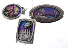 TWO HANDCRAFTED TONY KEAN STERLING SILVER AND TITANIUM LANDSCAPE BROOCHES AND A PENDANT OF CONFORMING DESIGN