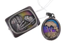 A HANDCRAFTED TONY KEAN STERLING SILVER AND TITANIUM LANDSCAPE BROOCH AND CONFORMING PENDANT.