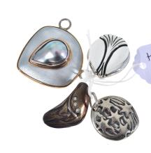 FOUR ASSORTED HANDCRAFTED STERLING SILVER AUSTRALIAN SIGNED PENDANTS INCLUDING ENAMEL AND DIAMOND.