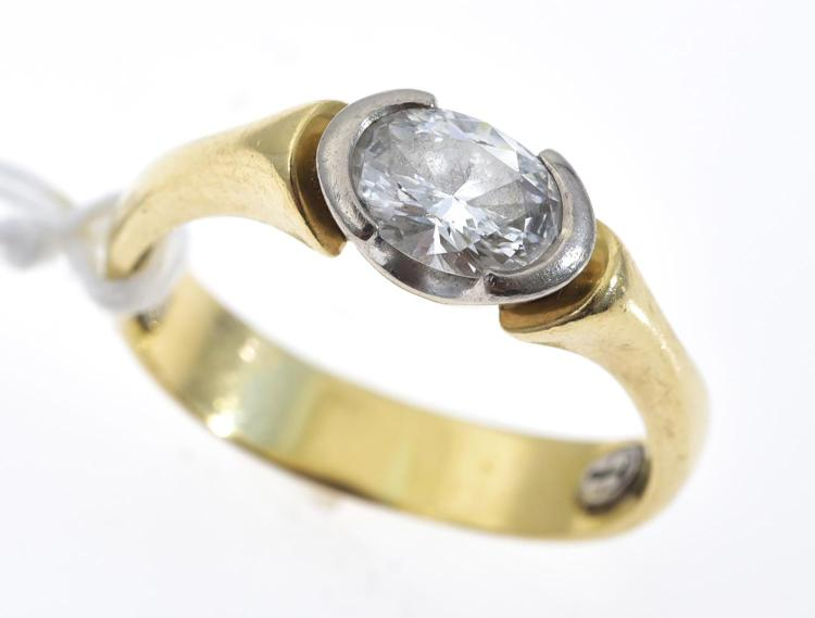A HANDCRAFTED DIAMOND SOLITAIRE RING BY MAKERS MARK, THE OVAL CUT DIAMOND OF 0.75CTS SET IN 18CT GOLD
