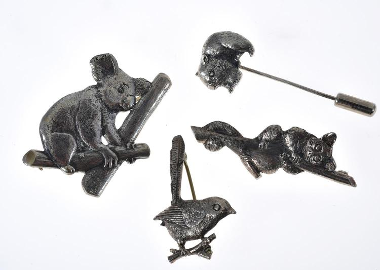 THREE HANDCRAFTED TONY KEAN STERLING SILVER BROOCHES MODELLED AS A POSSUM, LYREBIRD, AND A KOALA AND A CONFORMING STICK PIN DEPICTIN...