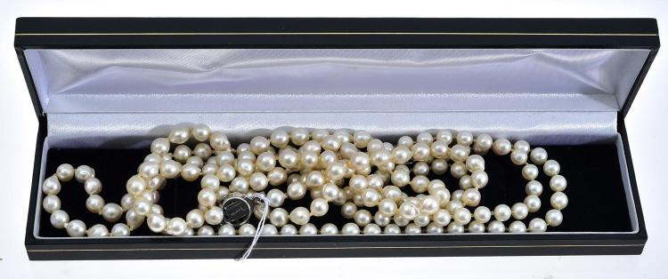 TWO STRANDS OF CULTURED PEARLS WITH SILVER CLASPS