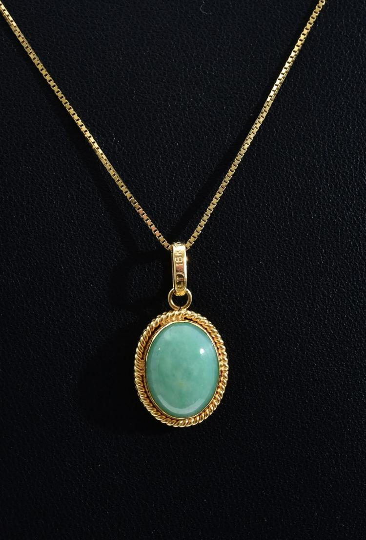 A JADE PENDANT ON GOLD CHAIN