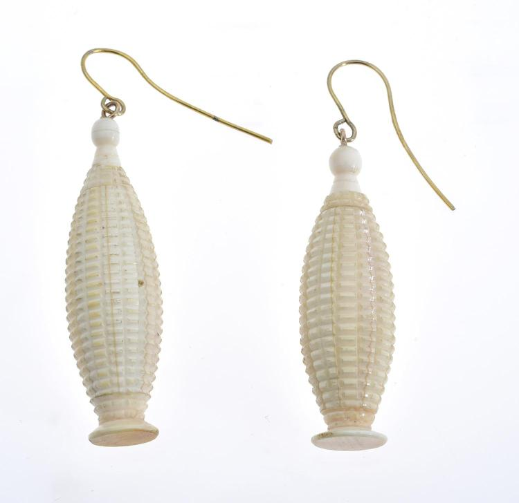 A PAIR OF CARVED EARRINGS