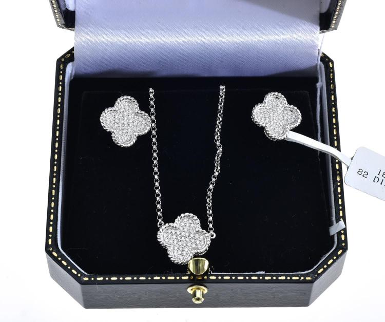 A DIAMOND AND SILVER SUITE INCLUDING EARRINGS AND NECKLACE FEATURING A CLOVER MOTIF IN 18CT GOLD