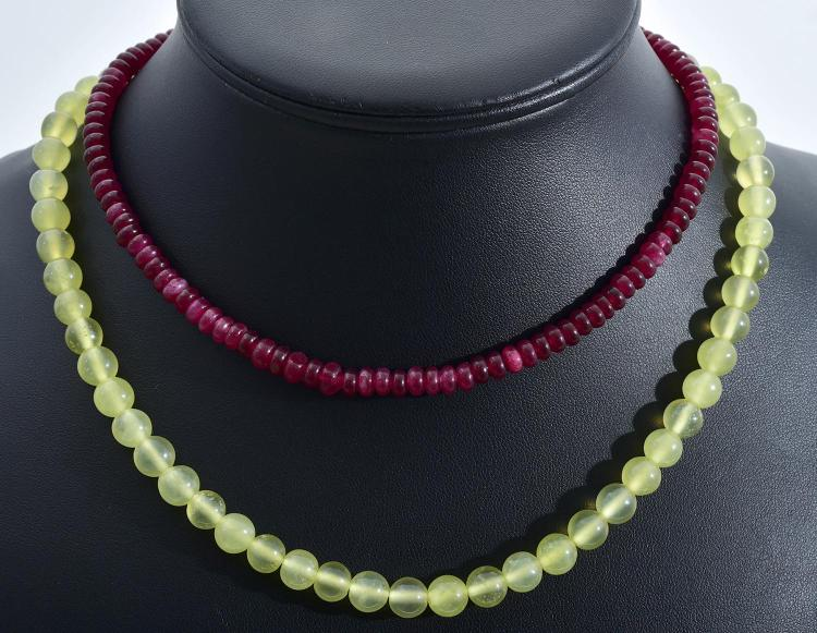 A RUBY BEADED NECKLACE TOGETHER WITH A JADE BEADED NECKLACE