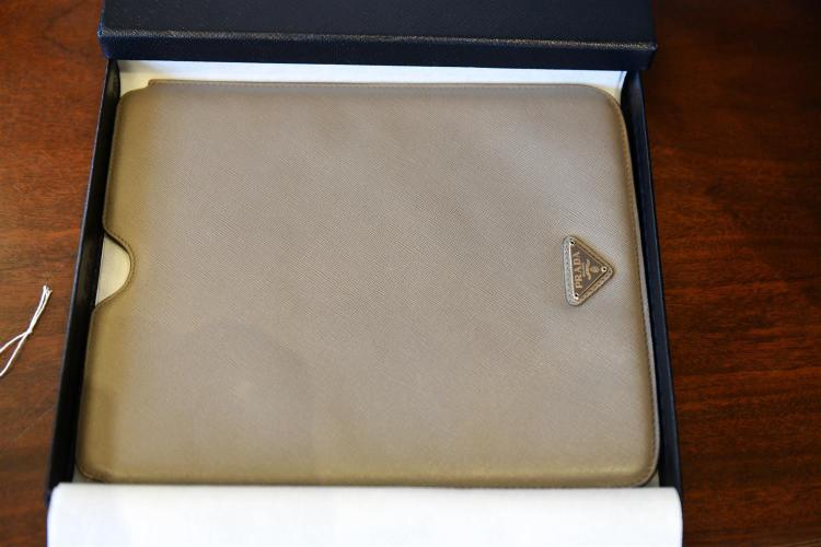A PRADA SAFFIANO LEATHER IPAD CASE IN GREY WITH ORIGINAL BOX.