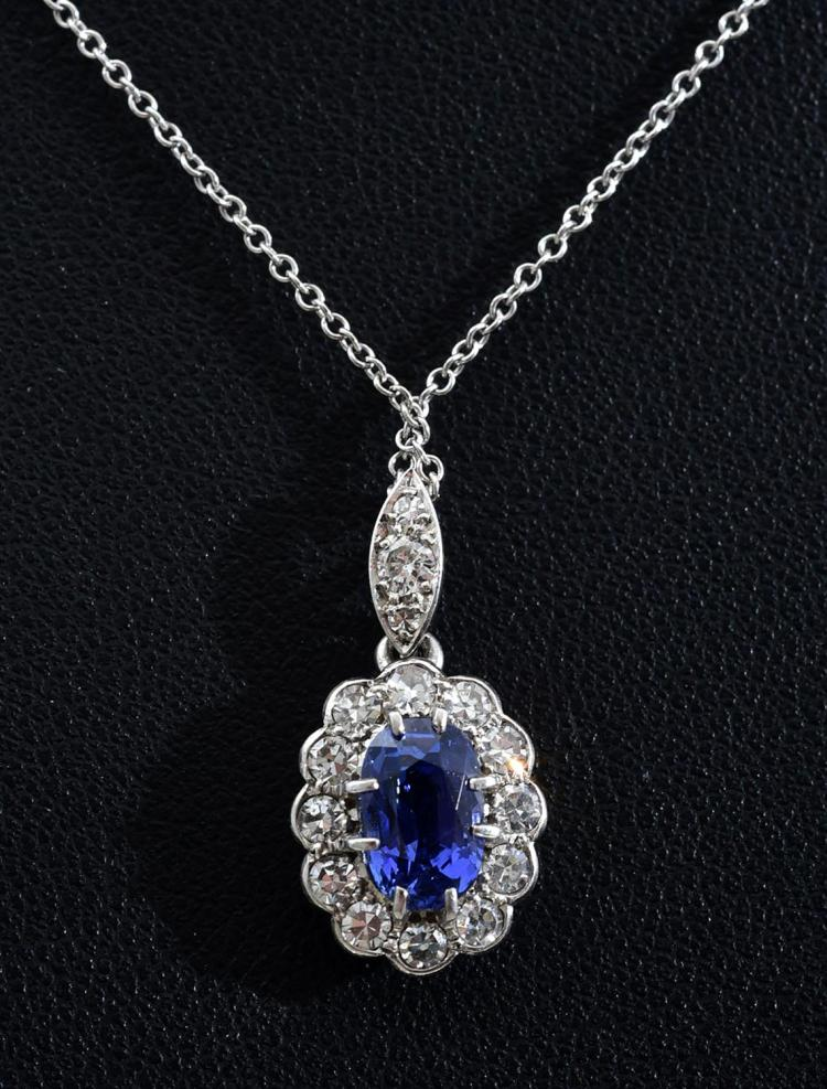 A SAPPHIRE AND DIAMOND FLOWER CLUSTER PENDANT SET IN 18CT WHITE GOLD ON A 9CT WHITE GOLD CHAIN