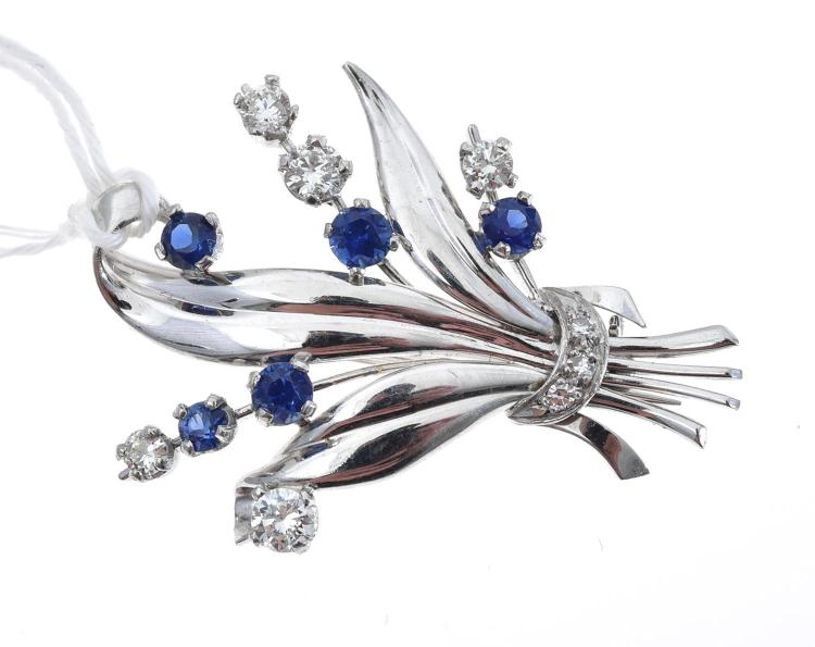 A SAPPHIRE AND DIAMOND FLORAL SPRAY BROOCH SET IN PLATINUM AND 18CT WHITE GOLD