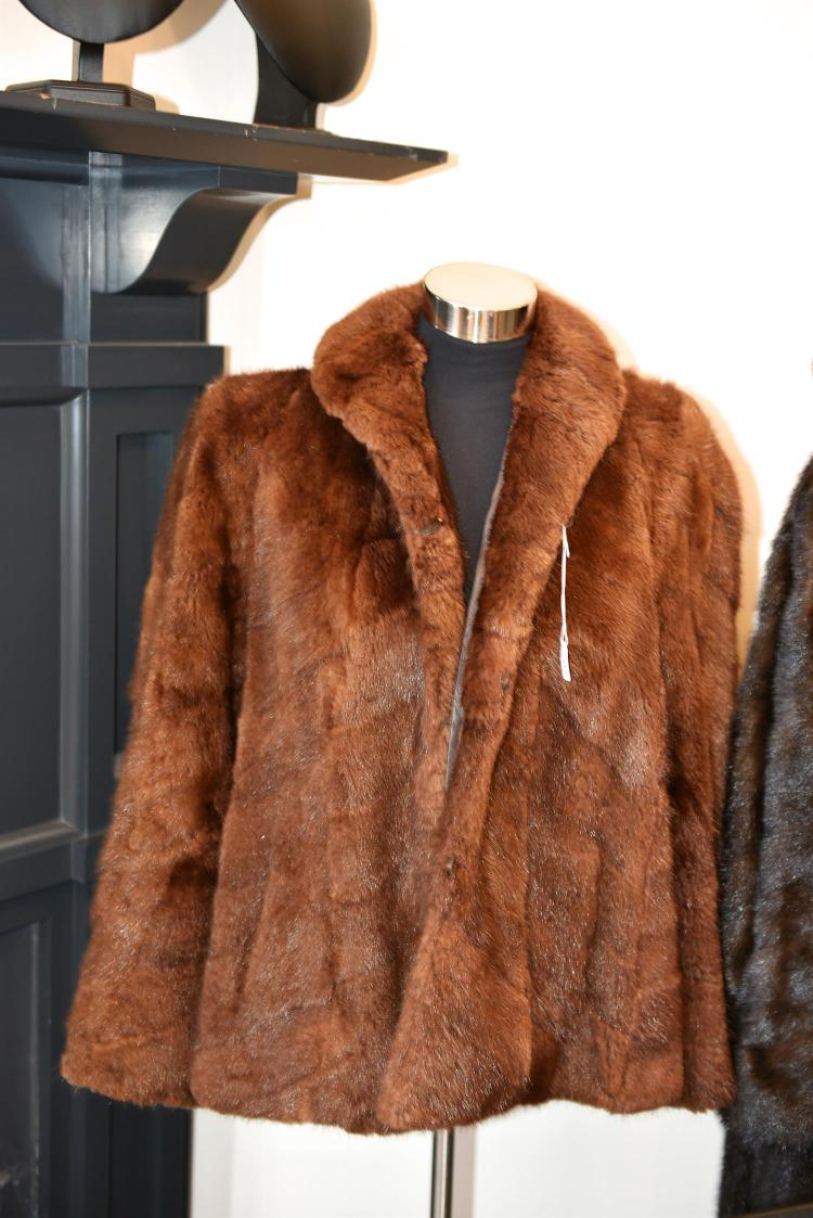 A MIDLENGTH LADIES FUR JACKET